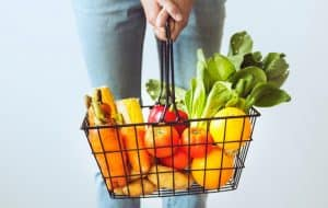 woman holding grocery basket
