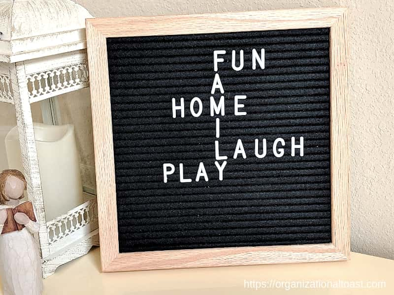 """Fun. Family. Home. Laugh. Play"" Quote on letter board"