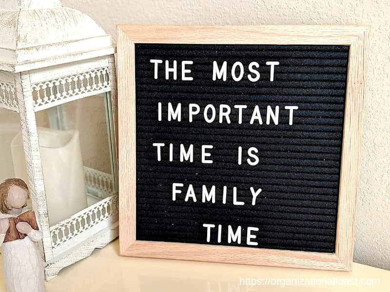"""The most important time is family time"". Quote on letter board"