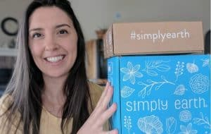 Jill holding Simply Earth Boxes for Simply Earth April 2019 Review Featured Image - Holding up Subscription boxes