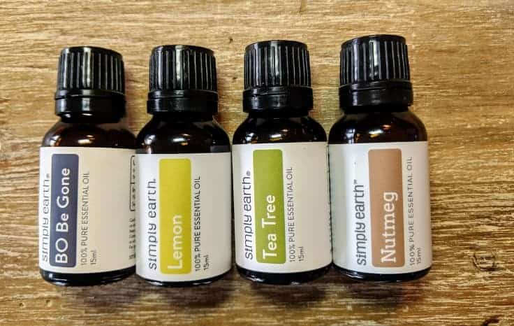 4 Simply Earth Essential Oils Bottles Lined up