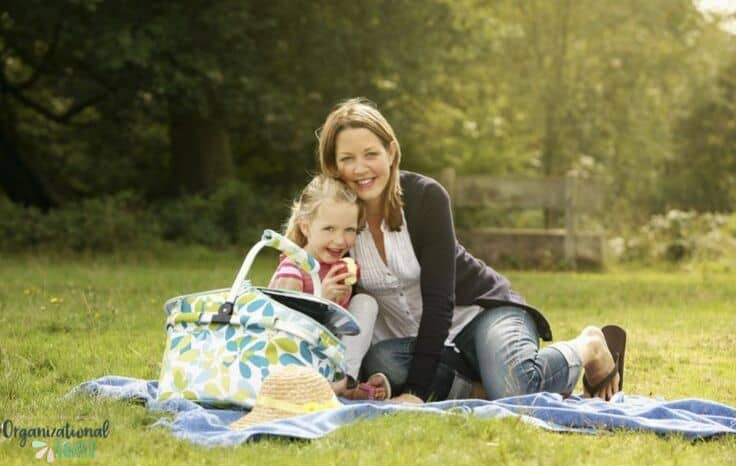 mother and daughter with picnic blanket